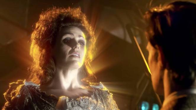 Idris, glowing gold, hovers before the Doctor, saying goodbye and hello