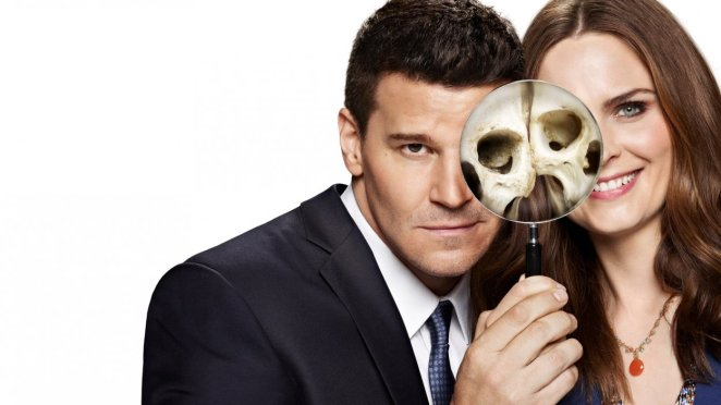 Promo shot of Booth and Brennan, heads together, looking through a magnifying glass. The parts of their faces seen through the glass are skulls.