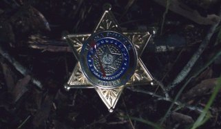 Judd Crawfords bloodied police badge