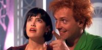 A promo image of Drop Dead Fred where Phoebe Cate's side eyes an upside down Rik Mayall.