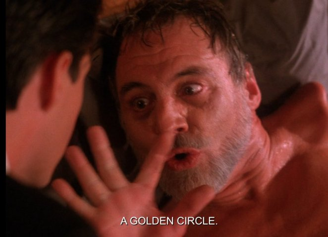 Mike warning Cooper about the jade and golden ring