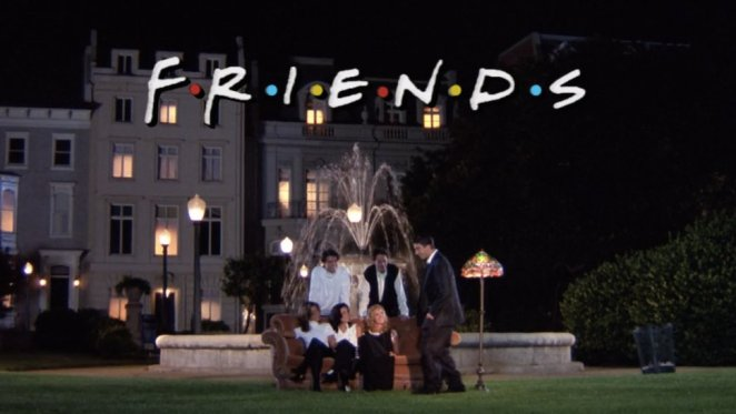 The cast of Friends stands and sits before a fountain
