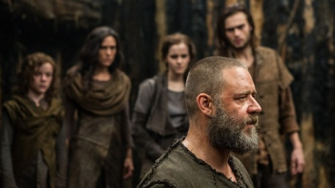 Noah stands in front of his family