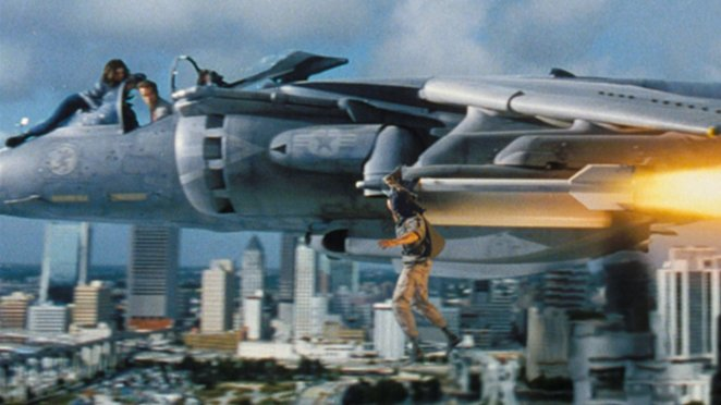 Aziz hangs from the plane's missile piloted by Harry, and his daughter Dana holds onto the pilot window