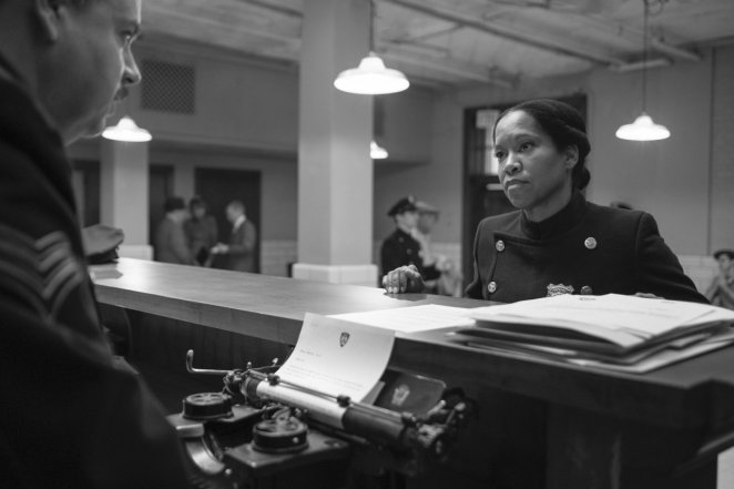 Angela Abar (Regina King) confronts a police officer at the pricinct.