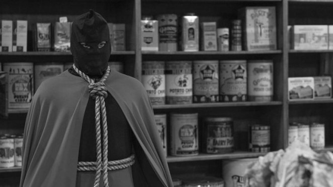Hooded Justice stands in the convenience store.