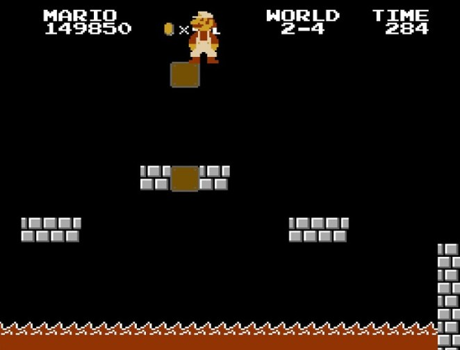 World 2-4: Mario stands over a lava pit in Bowser's second castle.