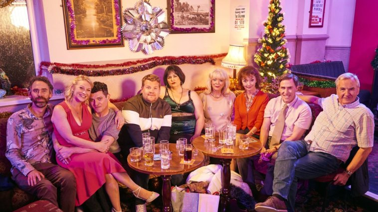 The Shipmans and the Wests pose for a family photo in the pub at christmas