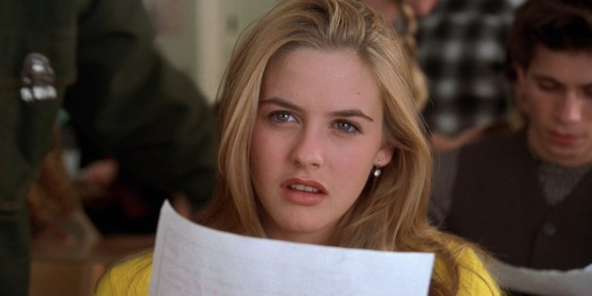 Cher in Clueless holding a paper and looking up in disbelief
