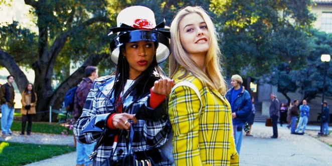 Cher and Dionne back to back in Clueless, Cher looking to her upper right and Dionne looking to her lower left