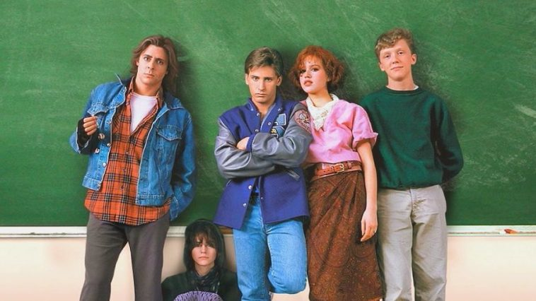 John Bender, Claire Standish, Andrew Clark, Brian Johnson and Allison Reynolds pose against a chalkboard in a school classroom