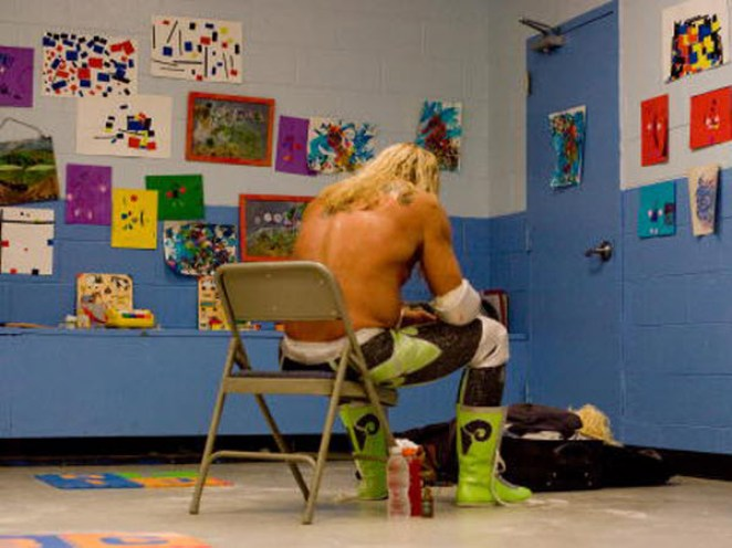 Randy the Ram sits on a chair in a classroom acting as a locker room, facing the wall