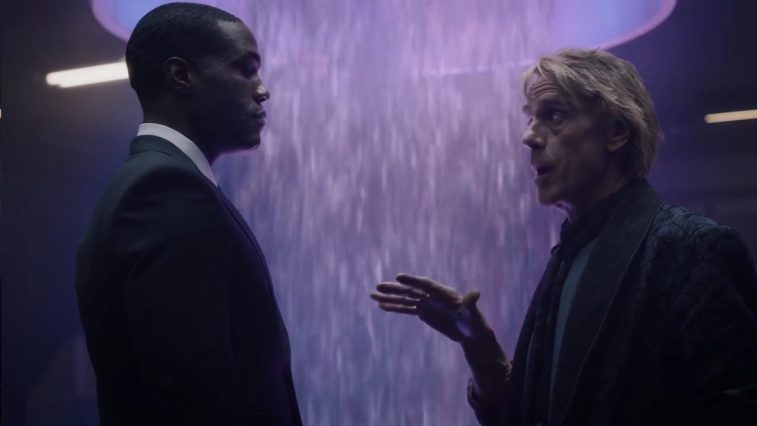 Watchmen - Jon and Cal are talking in front of the purple squidfall
