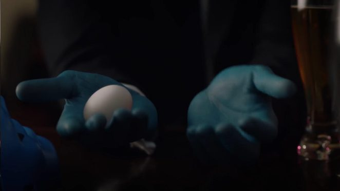Watchmen - A pair of blue hands, holding an egg in one