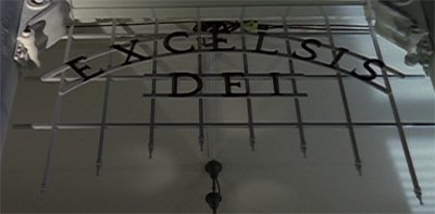 The gothic framework of the gate, its name Excelsis Dei is made out of thin iron