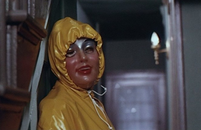 a child murderer in Alice Sweet Alice, wears a yellow raincoat and translucent mask