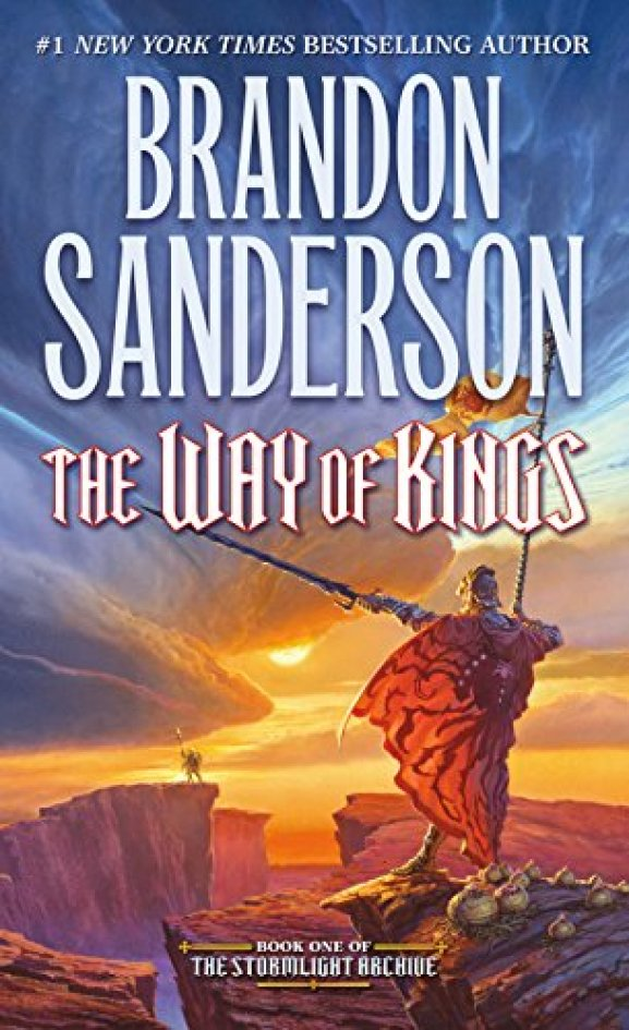 The cover of The Way of Kings,which features a man in resplendent armor holding a flag and large sword on a cliff, while a massive storm starts in the background