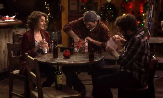 Maggie, Colt and Rooster open presents at the bar