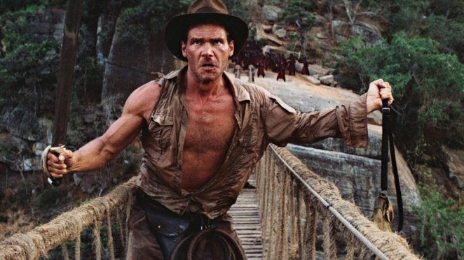Indiana Jones crosses a bridge with a whip and a sword