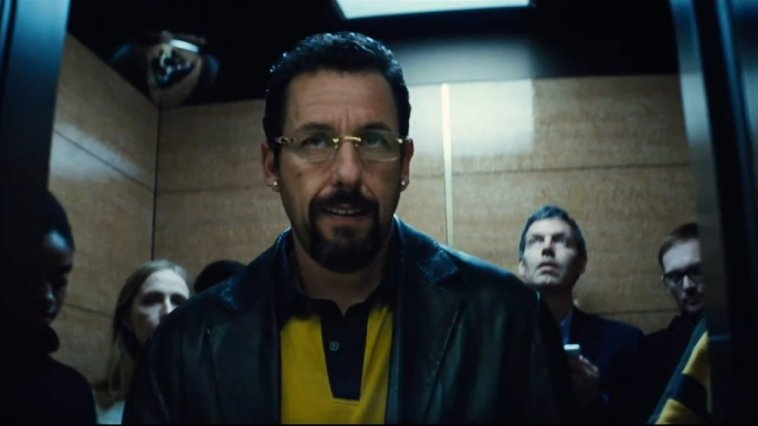 Adam Sandler exits an elevator full of people