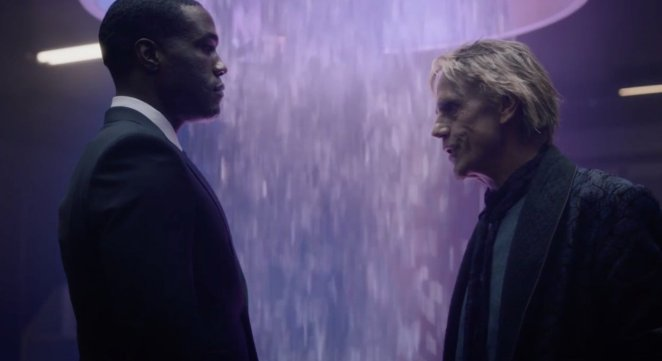 Cal and Veidt talk to each other as the squid rain falls into the portal behind them.