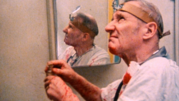 William S. Burroughs acts out a scene from Naked Lunch in Burroughs: The Movie