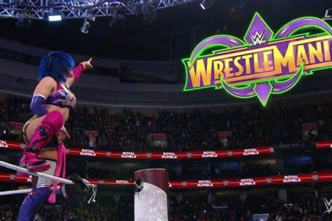 Asuka points to the WrestleMania sign after winning the first ever Women's Royal Rumble