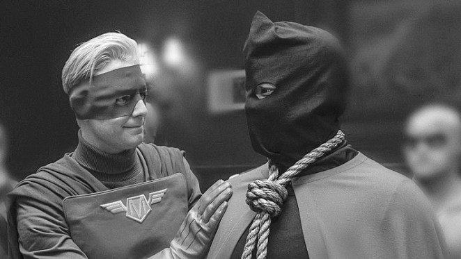 Captain Metropolis introduces Hooded Justice to the press