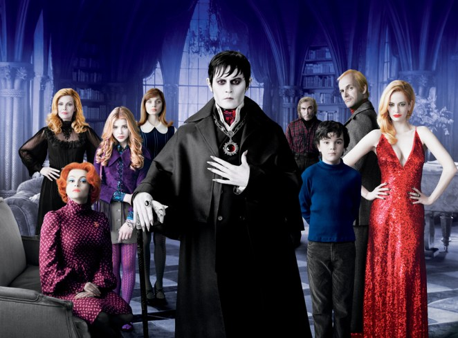 A group of people standing in a room dressed in Gothic style clothes