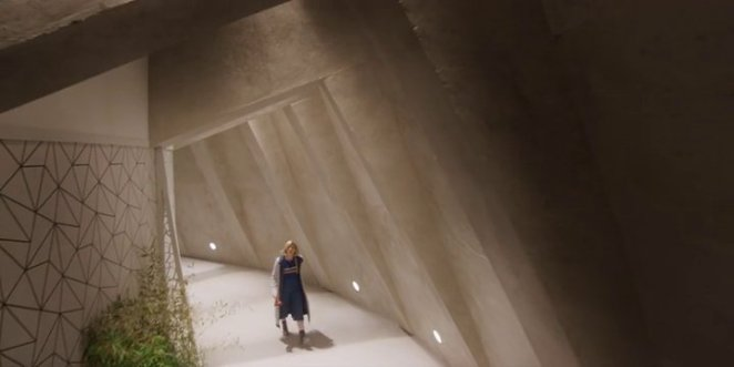 "The Doctor (Jodie Whittaker) walks through Tranquility Spa in ""Orphan 55."""