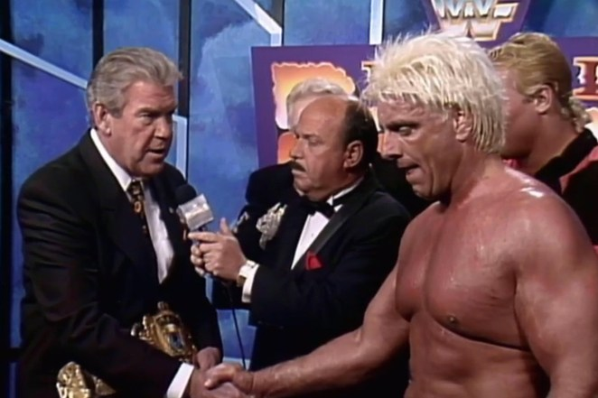 Ric Flair shakes Jack Tunney's hand and accepts the WWE title after the 1992 Royal Rumble
