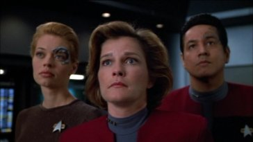 Seven of Nine, Janeway and Chakotay look at something