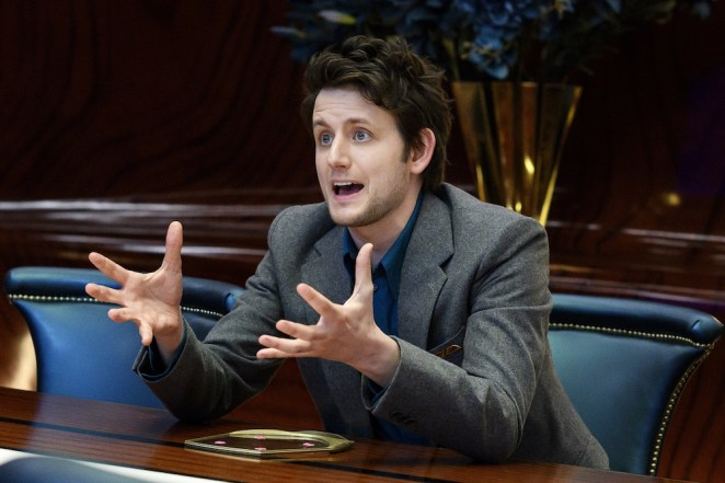 Matt (Zach Woods) shouts across a table in the conference room.