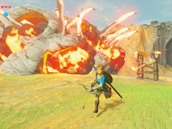 Link, having just fired a bomb arrow into a cave, with an explosion coming out of the cave.