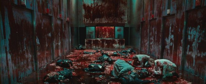 The floor is covered with corpses and the walls are covered with blood