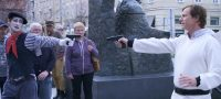 Owen Maestro (Rob Huebel) points a gun at a mime in Medical Police
