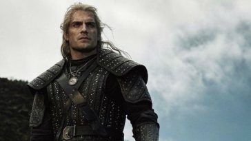 Geralt (Henry Cavill) stands on a cliff, looking into the distance.