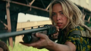 Emily Blunt points a shotgun at an unknown figure