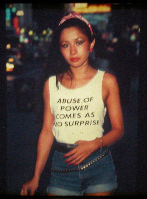 "sarahdeetz: This is Lady Pink, one of the only female graffiti artists active in the '80s. Jenny Holzer, famous for her feminist postmodern ""Truisms,"" designed this shirt and Lady Pink wore it around NYC.  WOAH how did i go this long without knowing the story behind one of my favourite photographs of all time?!"