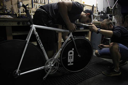 superbbicycle:</p> <p>Alex and Tom put the finishing touches on a vintage Rossin.<br />