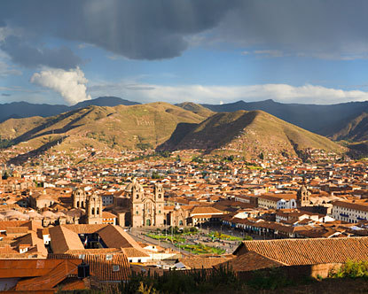 A view from a nearby mountainside shows the Plaza de Armas, main square of the Andean city of Cusco, Peru.