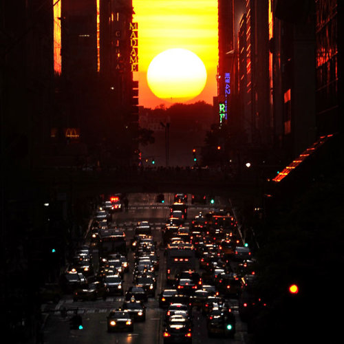 "Natural Occurrence of the Day: The semiannual solar phenomenon known as ""Manhattanhenge"" — wherein the sunset aligns with the east-west streets of Manhattan's main street grid — took place yesterday at precisely 8:17 PM. Above: Manhattanhenge, as observed from 42nd Street. [telegraph.]"