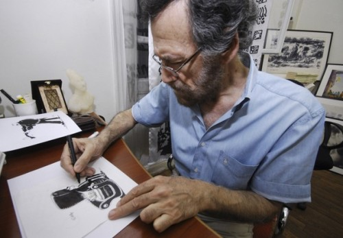 Syrian political cartoonist Ali Ferzat at work