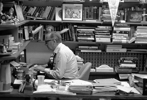 Walter Cronkite at his typewriter, in his office