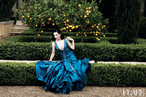 "flarefashion:  Dita von Teese - November 2006 / Art Director: Tanya Watt / Photographer: Max Abadian  ""I've been a huge fan of Dita von Teese for years. We shot her cover story in the garden of a gorgeous mansion in Southern California. The photographer, Max Abadian, gave me a framed print of this stunning shot for Christmas last year. The colours – Dita's jet black hair and porcelain skin, the vivid turquoise Elie Saab gown, the garden's greenery and lemons – inspired the décor of my bedroom."" — Lisa Tant, Editor-in-Chief / Associate Publisher of FLARE Click here to see more fashion and celebrity moments from our archive."