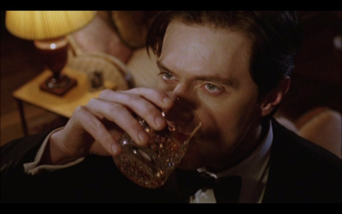 Richard Armitage drinks as Philip Durrant in Marple: Ordeal by Innocence.