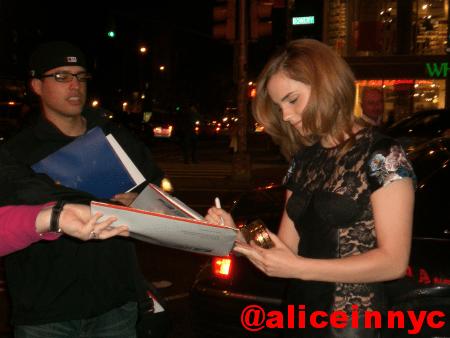 Emma signing autographs