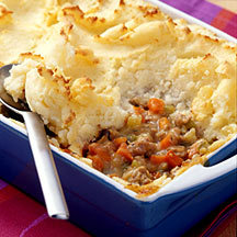 Weight Watcher's Shepherd's Pie 2  large  potatoes, peeled and cut into 2-inch pieces 1/4 cup  nonfat sour cream 1  tablespoon  reduced-calorie margarine 1/8 teaspoon  table salt 2  teaspoons  olive oil 1  cup  onion			 			 (chopped) 2  medium  carrots			 			 (diced) 2  medium  celery ribs, diced 1  lb  uncooked  			ground turkey breast (or morningstar farms recipe crumbles)3  tablespoons  all-purpose flour 1  tablespoon fresh rosemary, chopped or 1  teaspoon  dried rosemary 1  teaspoon  dried thyme 1/2 teaspoon  table salt 1/4 teaspoon  black pepper 2  cups canned chicken broth or 2  cups  beef broth (or vegetable for vegan) Preheat oven to 400ºF.    Place potatoes in a large saucepan and pour in   enough water  to cover potatoes. Set pan over high heat and bring to a   boil; reduce  heat to medium and simmer 10 minutes, until potatoes are   fork-tender. Drain potatoes, transfer to a large bowl and add sour cream   and  margarine; mash until smooth, season to taste with salt and set   aside. Meanwhile, heat oil in a large skillet over  medium-high heat.  Add  onion, carrots and celery; cook until soft, about 3  minutes. Add   turkey and cook until browned, breaking up the meat as it  cooks, about 5   minutes. Add flour, rosemary, thyme, salt and pepper;  stir to coat. Add broth and bring to a simmer; simmer until mixture  thickens, about 3   minutes. Transfer turkey mixture to a 9-inch, deep-dish  pie plate.  Spread  mashed potatoes over top and using the back of a  spoon, make   decorative swirls over the top. Bake until potatoes are  golden, about   30 minutes. Slice into 6 pieces and serve. Six servings, 275 Calories each