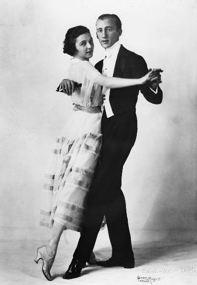 Vernon and Irene Castlewere a husband-and-wife team ofballroom dancersof the early 20th century. They are credited with invigorating thepopularityof modern dancing.Vernon Castle(2 May 1887 - 15 February 1918) was bornWilliam Vernon BlythinNorwich,Norfolk,England.Irene Castle(17 April 1893 - 25 January 1969) was bornIrene Foote, the daughter of a prominent physician inNew Rochelle, New York. In addition to cabaret, the Castles also became staples of Broadway. Among their shows wereThe Sunshine Girl(1913) andWatch Your Step(1914), which boasted a score written byIrving Berlinwith them in mind. Emerging as America's premier dance team, the Castles were trendsetters in a number of arenas. Their infectious enthusiasm for dance encouraged admirers to try new forms of social dance. Considered paragons of respectability and class, the Castles specifically helped remove the stigma of vulgarity from close dancing. The Castles' performances, often set to ragtime and jazz rhythms, also popularized African-American music among well-heeled whites. Irene's fashion sense, too, started national trends. Her elegant, yet simple, flowing gowns were often featured in fashion magazines. She is also credited with introducing American women to the bob—the short hairstyle favored by flappers in the 1920s. The whisper-thin, elegant Castles were trendsetters in many ways: they traveled with a black orchestra, had an openlylesbianmanager, and wereanimal-rightsadvocates decades before it became a public issue. Irene was also a fashion innovator,bobbingher hair ten years before theflapperlook of the 1920s became popular The Castles endorsedVictor RecordsandVictrolas, issuing records by the Castle House Orchestra, led byJames Reese Europe–– a pioneering figure inBlack music. The Castles' greatest success was onBroadway, inIrving Berlin's debut musicalWatch Your Step(1914). In this extravaganza, the couple refined and popularized theFoxtrot, which vaudevillecomedianHarry Foxis believed to have inv