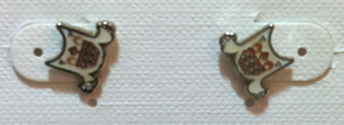 Earrings that are braces?  I'm not 100% sure these are teeth, but it definitely looks like braces!!